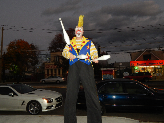 Juggling Clown On Stilts