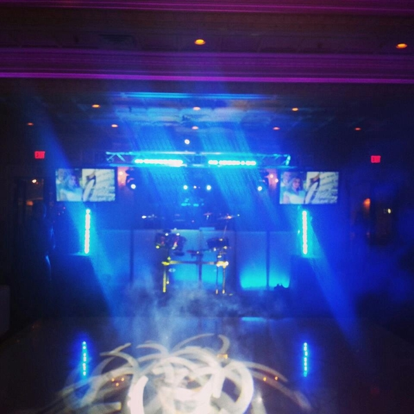 Wedding DJ set up with automated truss lights